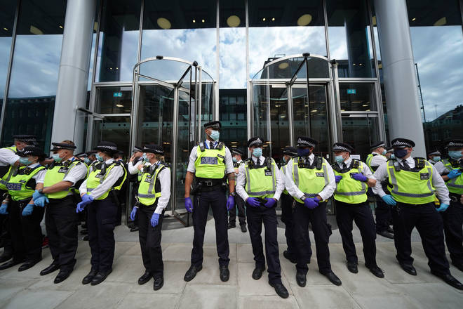 """Police outside the offices of ITN on Grays Inn Road, London, after a group of protesters """"unlawfully gained access"""" to the building."""