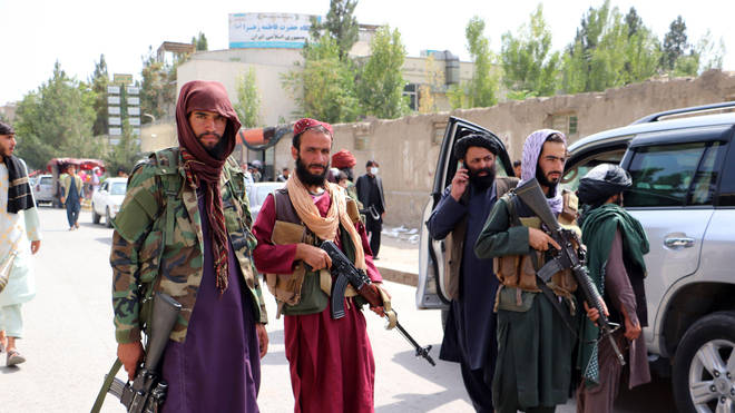 """The Taliban have said extending the deadline would """"cross a red line"""", with a decision due from Joe Biden within 24 hours"""