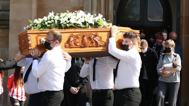 The coffin of Samantha Willis from Strathfoyle is taken from St Columb's Church, Londonderry, after her funeral. The mother-of-four died with Covid-19 shortly after giving birth on Friday.