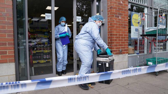 Forensics officers at one of the supermarkets yesterday