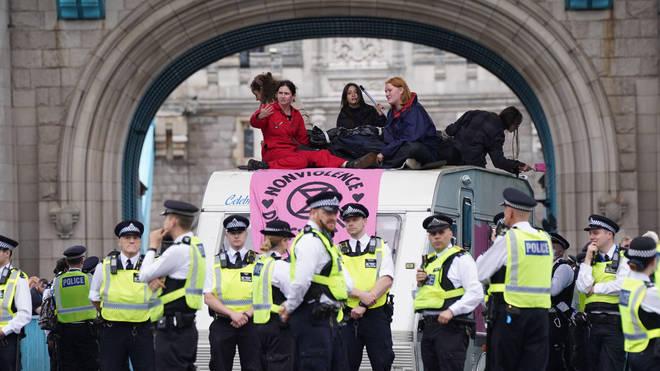 Extinction Rebellion protesters have blocked Tower Bridge after descending on London on Monday
