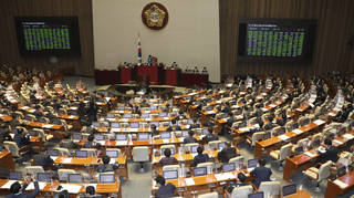 South Korea's legislators attend a plenary session to proceed with pending bills at the National Assembly in Seoul
