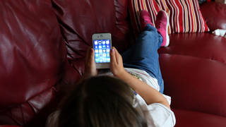 Child using a smartphone
