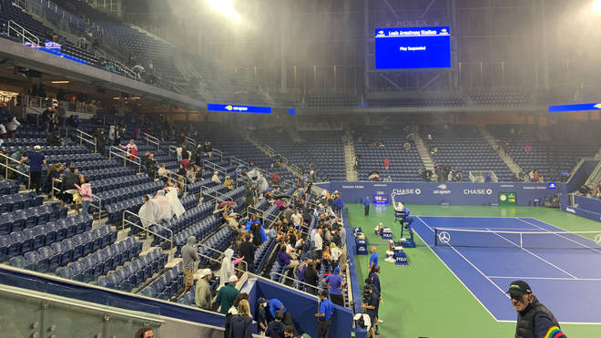 Play was brought to a halt at the US Open as rainwater broke through the roof
