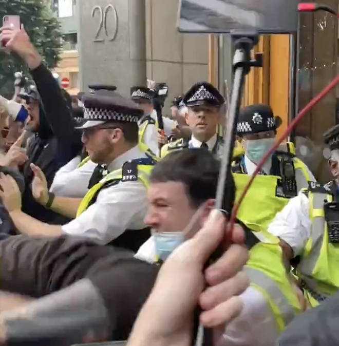 The group of anti-vax protestors attempted to gain access to the medicines regulator's HQ in Canary Wharf