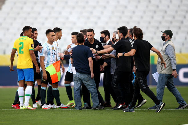The game descended into farce with health officials walking on to the pitch