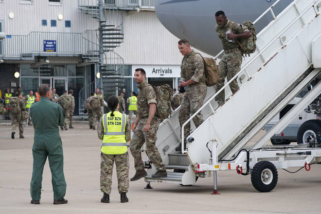 UK troops pictured arriving back in the country last month