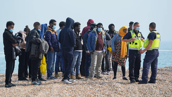 A group of people thought to be migrants are brought ashore from the local lifeboat at Dungeness in Kent, after being picked-up following a small boat incident in the Channel.