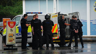Armed police have detained a man after multiple people were held at knifepoint at a Bristol petrol station.