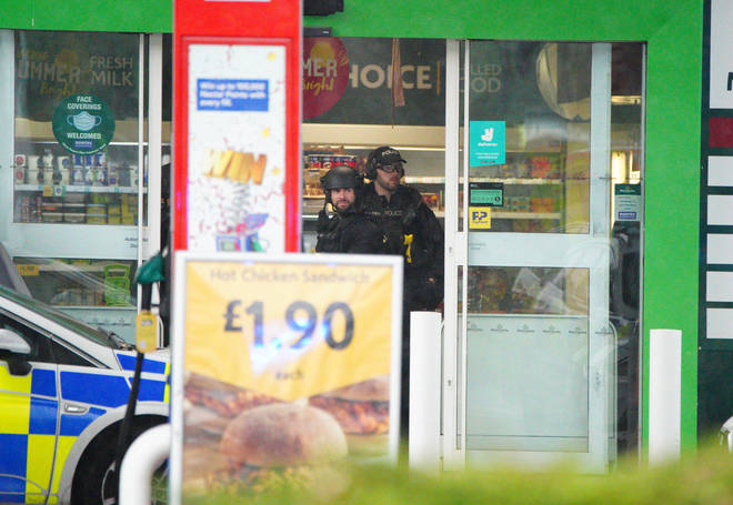 Armed police were seen in the Morrisons shop at the petrol station.