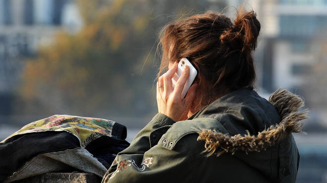 Person using their mobile phone