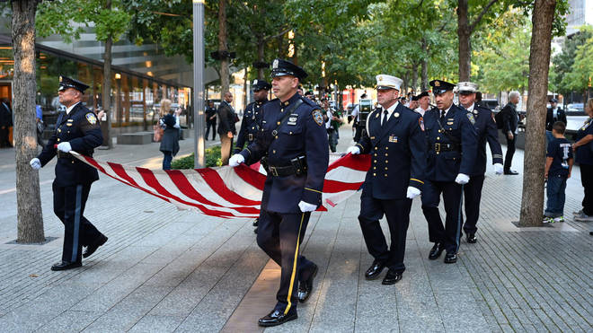 A symbolically torn US flag was paraded through those gathered at Ground Zero.