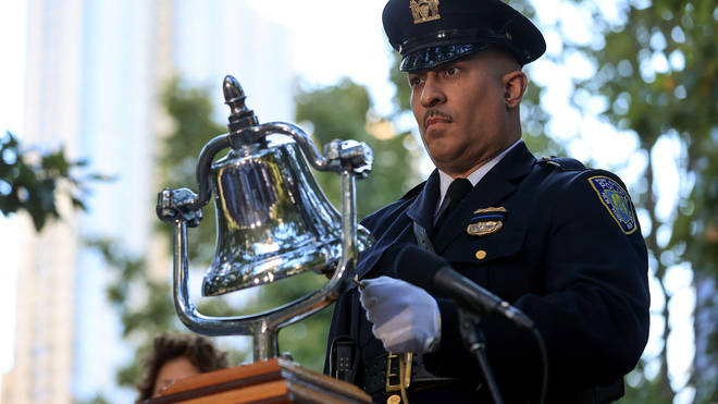 A bell was rung to signal six minutes of silence during the ceremonies.