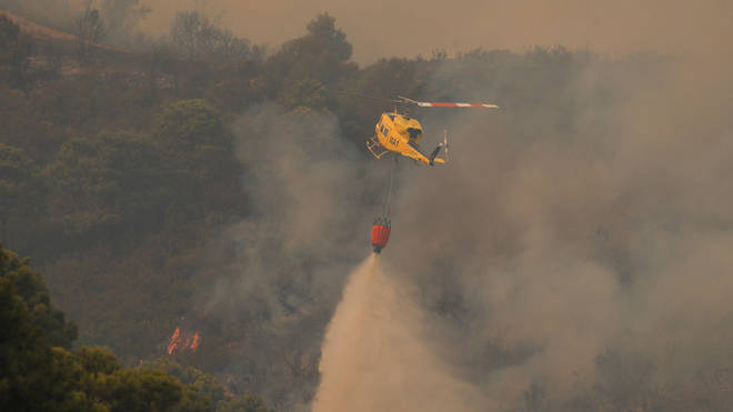 Helicopters have been making water drops in an attempt to get the fire under control.
