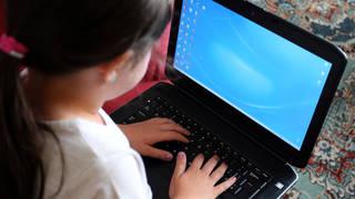 Child uses laptop