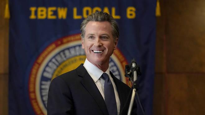 California governor Gavin Newsom speaks to reporters