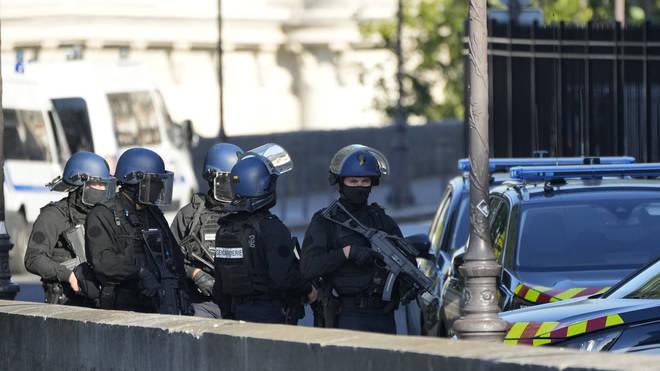 Security forces patrol outside at the Palais de Justice in Paris