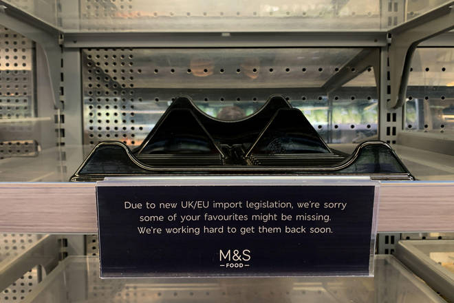 Signs had appeared on shelves in M&S stores blaming shortages on post-Brexit travel rules.