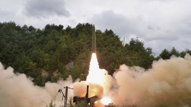 A test missile is launched from a train in North Korea