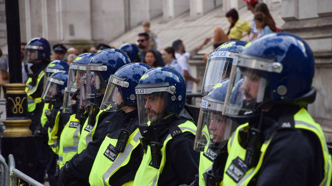 Police surrounded Downing Street as protesters arrived.