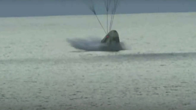 The SpaceX capsule carrying four people splashes down in the Atlantic off the Florida coast