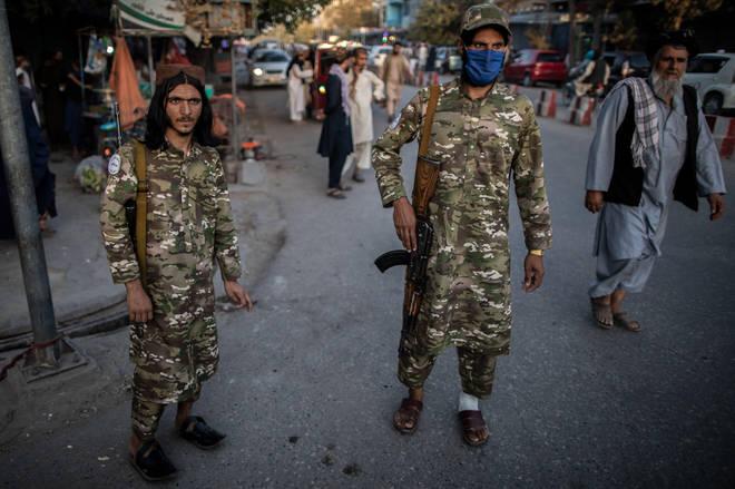 Taliban policemen patrol a street in Kunduz, northern Afghanistan