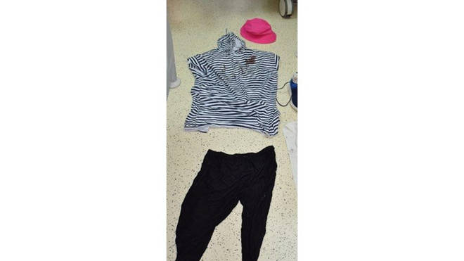 Police said that she was discovered wearing a blue striped t-shirt, black trousers and a pink hat.