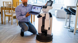 Dr Mauro Dragone with the assisted living robot