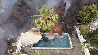 Hot lava reaches a swimming pool on the island of La Palma