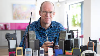 Ben Wood, founder of the Mobile Phone Museum, pictured with some of the over 2,000 unique mobile phones that will be part of the online museum when it launches in November