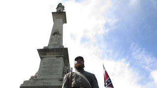 Cameron Maynard stands at attention by the monument to Confederate soldiers at the South Carolina Statehouse in Columbia, South Carolina (Jeffrey Collins/AP)