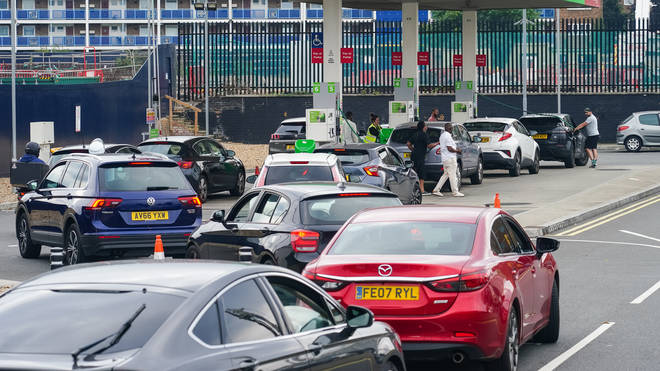 Cars queue for fuel at an Asda petrol station in south London