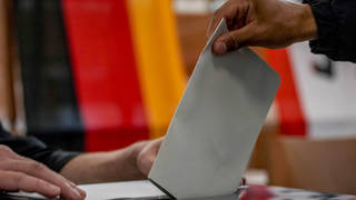 A man casts his ballot for the German elections in a polling station in Berlin