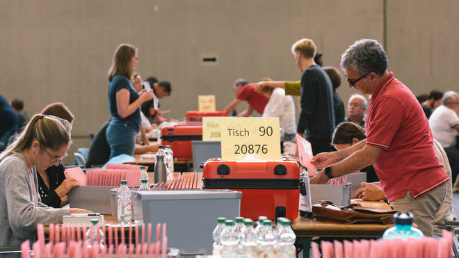 Staff members counted votes into the early hours of Monday.