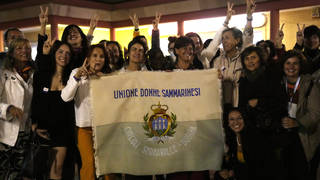 Activists in San Marino celebrate the referendum results