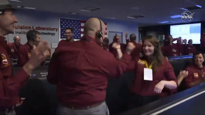 NASA Employees Celebrate Mars Landing With Out of This World Handshake