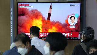 People watch a TV showing a file image of North Korea's missile launch during a news program at the Seoul Railway Station on Tuesday