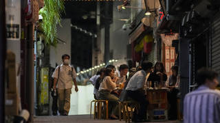 People gather at bars in Japan