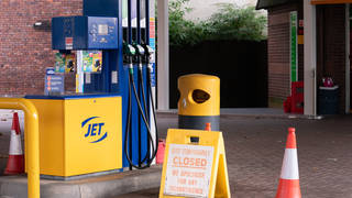 A closed sign on the forecourt of a petrol station in Leeds (Danny Lawson/PA)