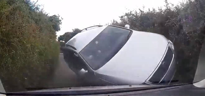 Shocking Moment Car Flips Onto Side After Speeding Down A Country Lane
