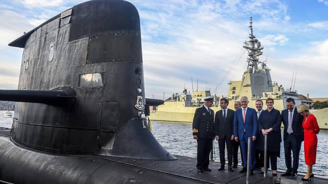 Malcolm Turnbull and Emmanuel Macron on a submarine