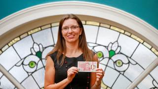 Sarah John with a new banknote