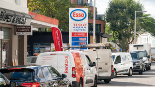 Vehicles queue for fuel at a petrol station in west London (Dominic Lipinski/PA)