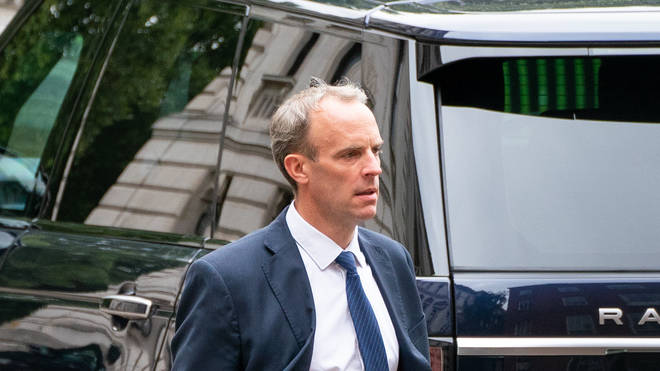 Dominic Raab walks to the rear entrance of Downing Street