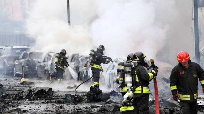 Firefighters at the scene following the crash
