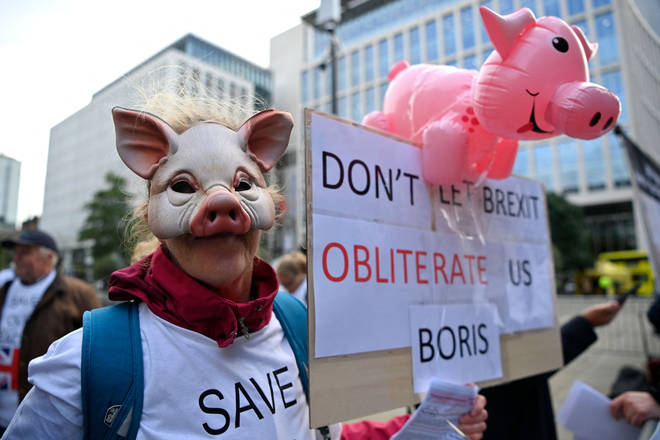 A pig farmer protests outside the Conservative Party conference on Monday