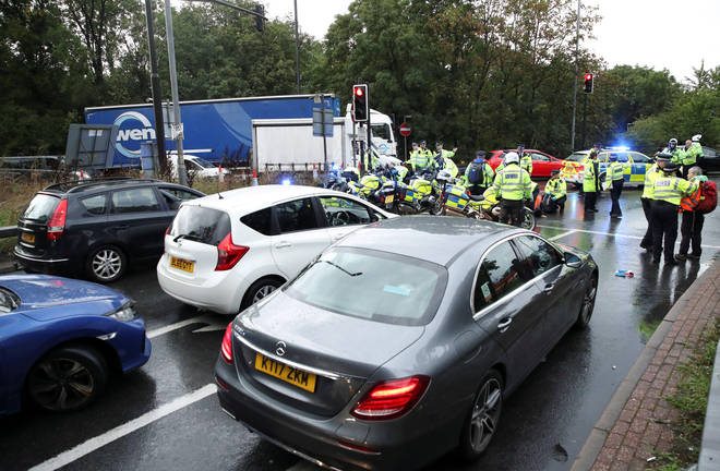 Insulate Britain activists block a motorway junction near Heathrow Airport on Friday