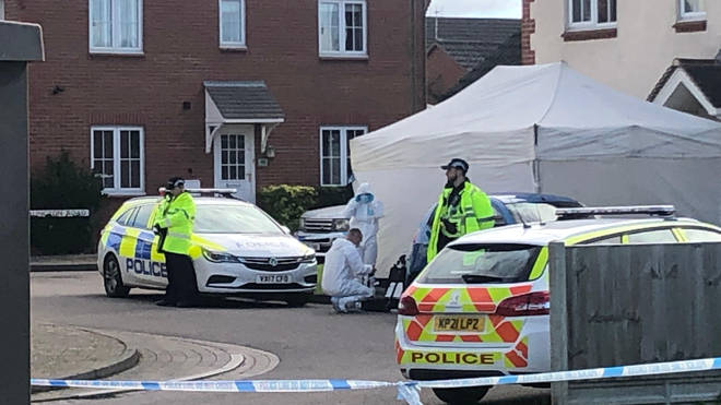 White forensic tents have been placed over the front doors of two adjacent properties in Snowdonia Road, Walton Cardiff.