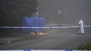 Forensic investigators at the scene in Oxford today
