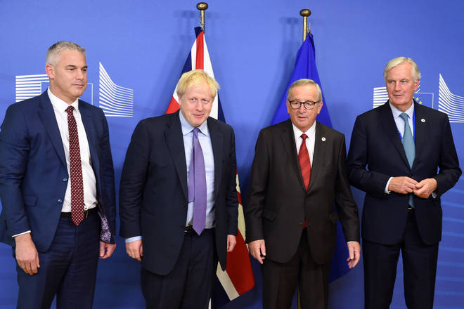 The UK's Stephen Barclay and Boris Johnson with the EU's Jean Claude Juncker and Michel Barnier after the Brexit deal agreement in October 2019
